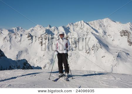 Alpine Skier Mountains In The Background