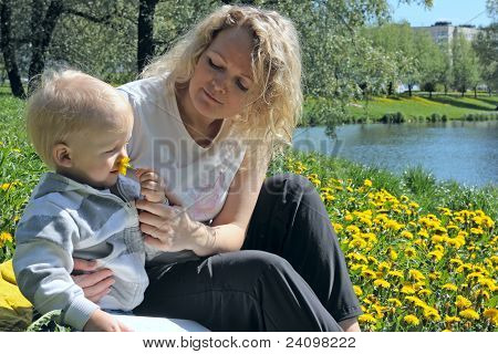 mother and child smelling a flower