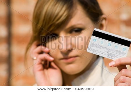 Girl With Credit Card And Mobile Phone