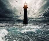 stock photo of lighthouse  - Stormy sky over flooded lighthouse - JPG