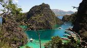 Tropical Lagoon With Azure Water, Beach By The Kayangan Lake, Philippines. View Coron Island, With C poster