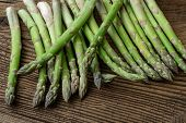 Raw Garden Asparagus Stems. Fresh Green Spring Vegetables On Wooden Background. (asparagus Officinal poster