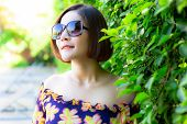 Portrait Attractive Beautiful Woman. Charming Beautiful Girl Wears Sunglasses And Beautiful Dress. G poster