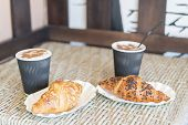 Cappuccino With Croissant. Two Cups Of Coffee With Milk Foam Stands On A Table In Cafeteria. Two Cup poster