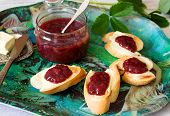 Strawberry Jam In A Glass Jar And Toast With Butter And Jam. Rustic Style, Selective Focus. poster