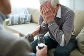 Crop Compassionate Person Consoling Elderly Man In Assisted Living Home Holding Glass Of Water. poster