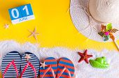 June 1st. Image Of June 1 Calendar On Yellow Sandy Background With Summer Beach, Traveler Outfit And poster