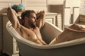 Wellness Spa Man Relaxing In Tub Spa Retreat. Handsome Young Male Model Relaxed With Eyes Closed Res poster