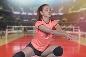 Female Professional Volleyball Player On Volleyball Court. poster