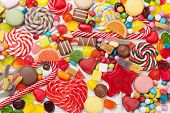 Colorful sweets. Lollipops and candies. Top view closeup poster