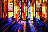 stock photo of pews  - stain glass reflections reflected off of church pews - JPG