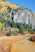 image of colorado high country  - River runs yellow in the high country of Colorado in Fall - JPG