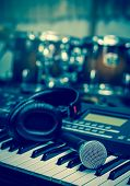Microphone On Music Keyboard With Music Brand Blurred Background, Music Instrument Concpet poster