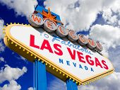 foto of las vegas casino  - Welcome to Las Vegas street sign in blue sky with clouds - JPG