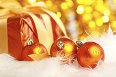golden christmas ball and gift on a furry background poster