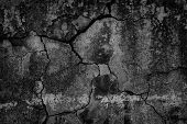 Old Cracked Black Concrete Wall. Weathered Cement Texture. Gloomy Dark Background poster
