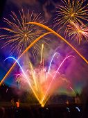 image of firework display  - Bright colorful fireworks display with multiple bursts - JPG
