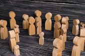 The Child Was Lost In The Crowd. A Crowd Of Wooden Figures Of People Surround A Lost Child. Lost, Pa poster