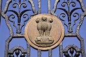 stock photo of rashtrapati  - Indian Four Lions Emblem Rashtrapati Bhavan Gate The Iron Gates Official Residence President New Delhi India Lions from Ashoka Emperor Symbolize Power Courage Pride and Confidence - JPG