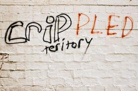 stock photo of crip  - Misspelled gang graffiti in a bad neighborhood - JPG