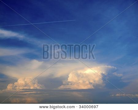 beautiful cloudscapes with the plane  in the background