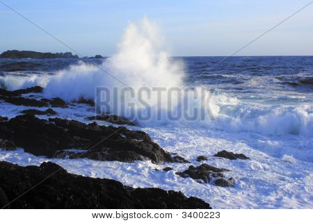 Giant Wave Crushing On A Rocky Beach