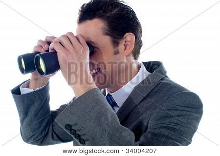 Male Executive Using Binoculars