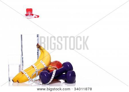 Water and fresh fruits over white background
