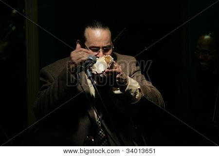 MADISON, NJ - JUNE 16: Steve Turre gestures as he blows into a conch seashell as he performs with his Quartet at Shanghai Jazz on June 16, 2012 in Madison, NJ.
