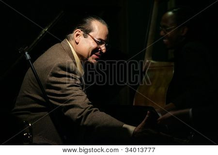 MADISON, NJ - JUNE 16: Steve Turre (L) reaches out to shake hands with restaurant owner David Niu (off camera) after performing with his Quartet at Shanghai Jazz on June 16, 2012 in Madison, NJ.