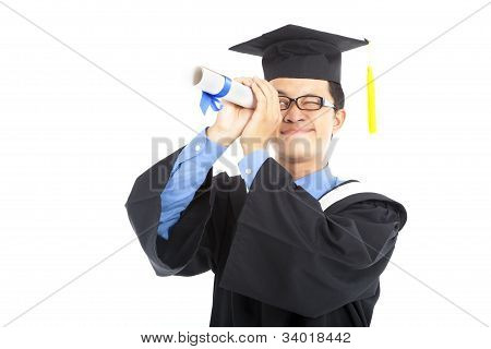 young graduating student watching by diploma