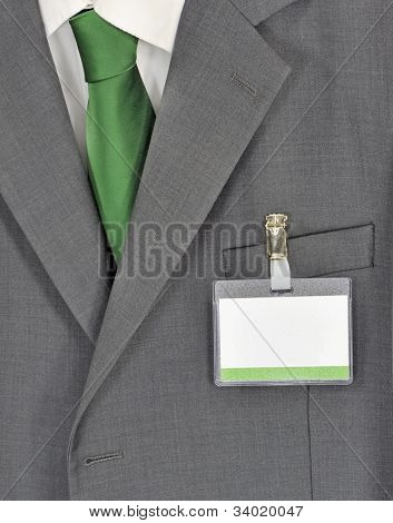 Male gray business suit green tie and name badge