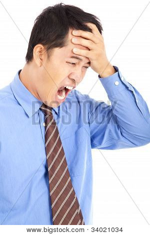 frustrated businessman with headache