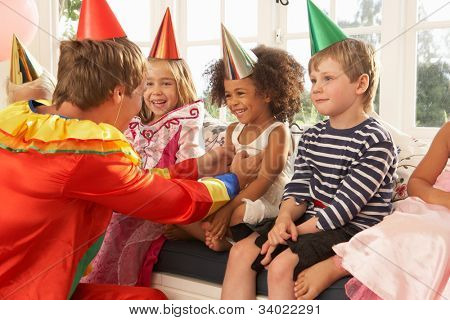 Clown entertaining children at party