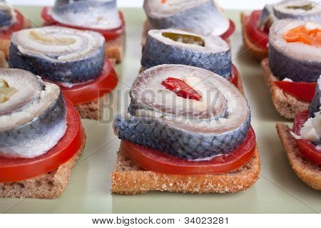 sandwiches with tomatoes and norwegian herring