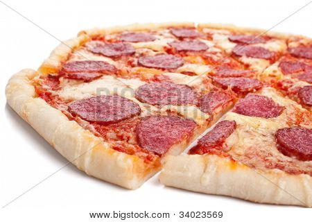 sliced whole salami pizza on white background