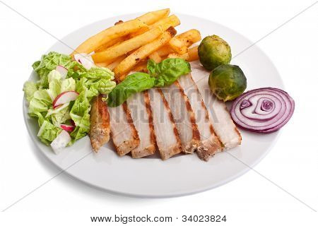 sliced pork chops with french fries and brussels sprouts