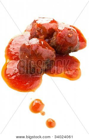three meatballs in tomato sauce on white background