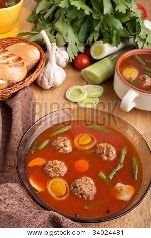 tomato soup with meatballs, leek and green beans