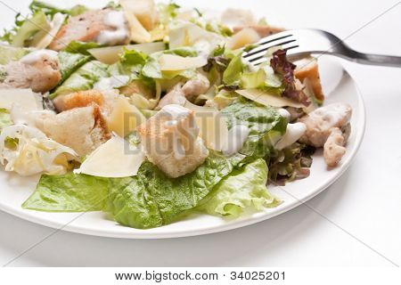 plate of traditional caesar salad with chicken