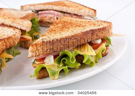 meat, lettuce and cheese sandwich on toasted bread
