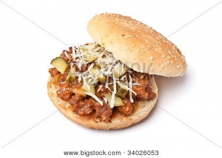Sloppy Joe tasty sandwich with grated cheese and pickles on white background