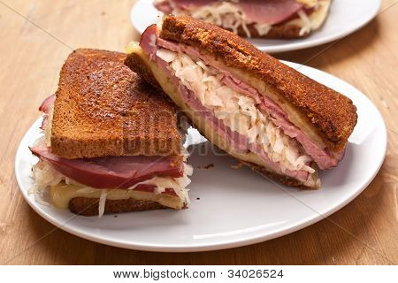 hot reuben sandwiches( rye bread, swiss cheese, corned beef and sauerkraut)