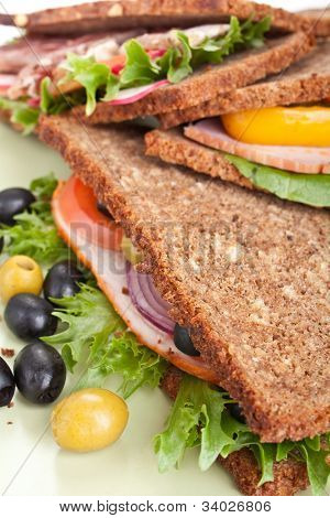 big healthy sandwiches made with whole grain bread, turkey breast and vegetables