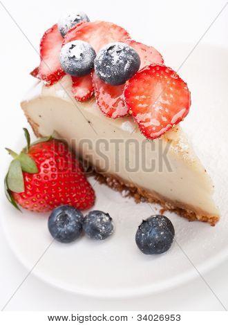 piece of tasty vanilla cheesecake with berries