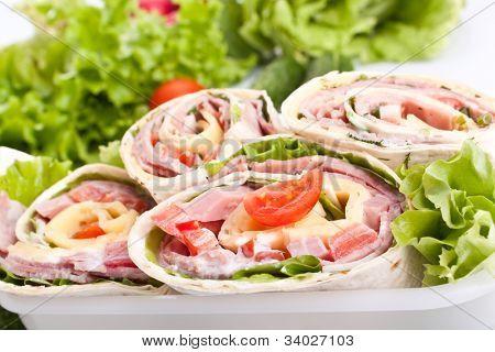 wrapped tortilla sandwich rolls cut in half