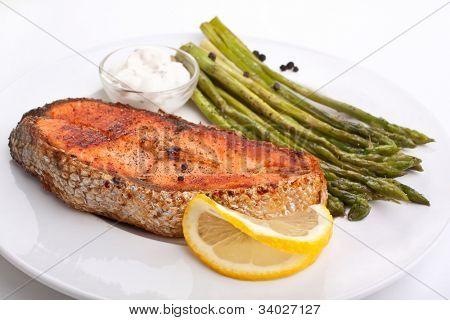 salmon with vegetables,lemon and sauce