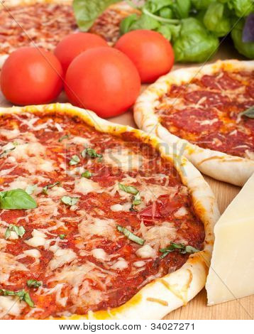 couple pizzas and ingredients