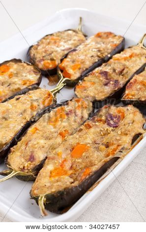 stuffed with cheese and mushrooms aubergines in a dish