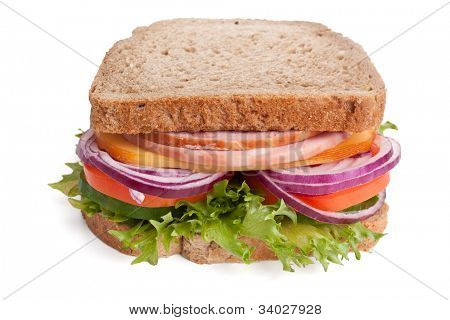 big whole wheat bread sandwich with meat and vegetables